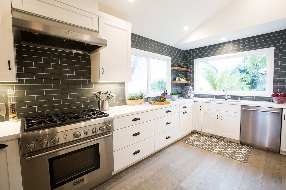 modern-industrial-kitchen-counter-stove-sink-tile-backsplash