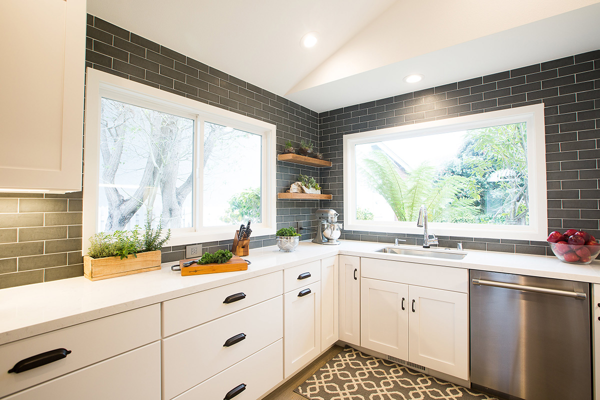 modern-industrial-kitchen-counter-white-cabinets-sink-windows