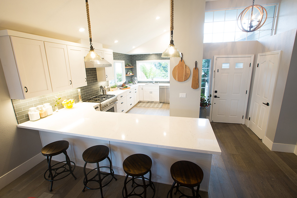 modern-industrial-kitchen-white-counter-peninsula