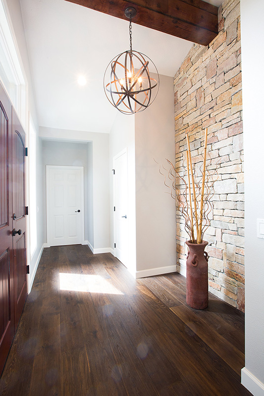entrance-wood-floors-exposed-wood-beams